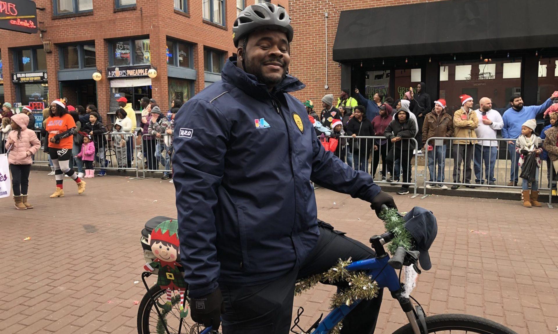 Blue Suede brigade member patrol on bike Beale Street Holiday Parade, Downtown Memphis