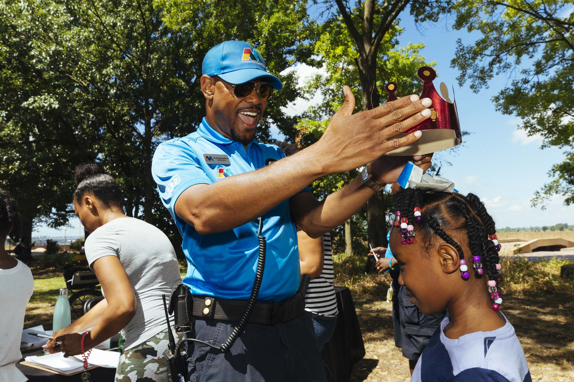 Blue Suede brigade member interacting with child on Mud Island River Park, Downtown Memphis